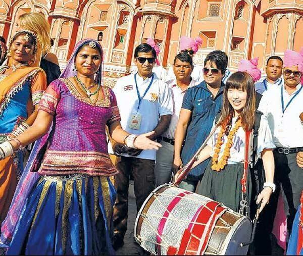 Traveler enjoying to play Rajasthan Dhol